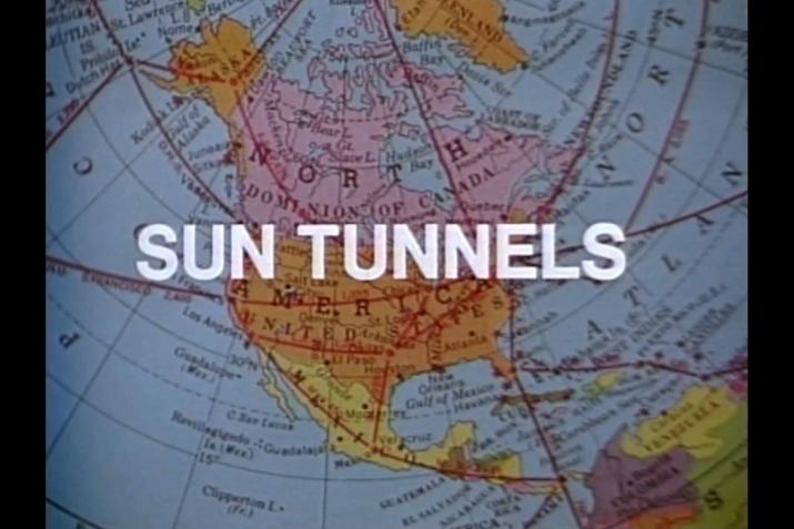 OPening shot from the Holt film Sun Tunnels showing the title text on a map of the USA.