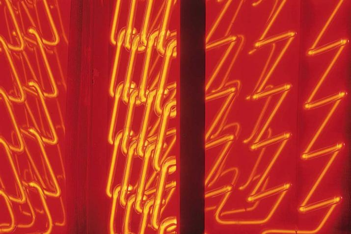 zig zagging lines of red neon light reflected in two mirrors