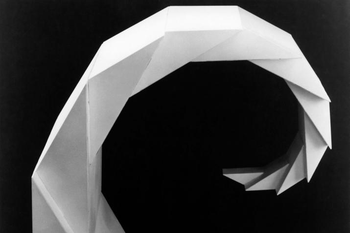 white geometric faceted spiraling sculpture with black background