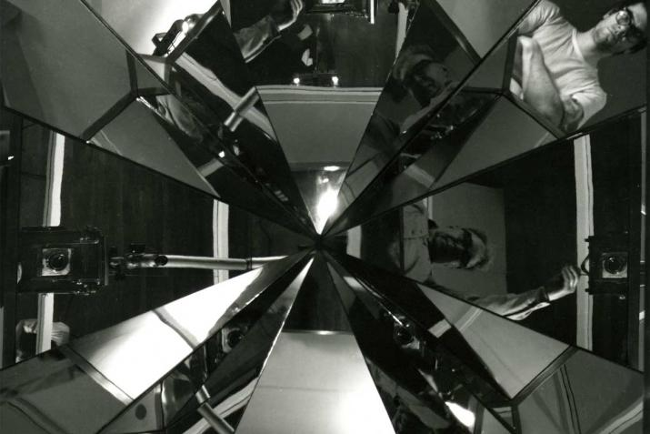 Black and white image of angular reflections converging at a center point