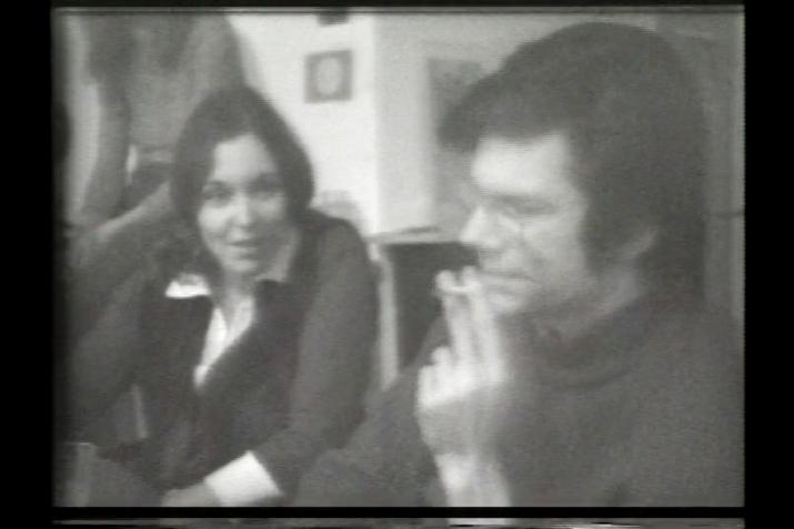 black and white, a young man and woman seated next to each other in conversation