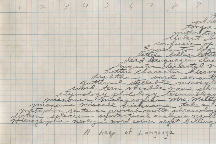 A graphite drawing on graph paper of a pyramid shape created by handwritten cursive text