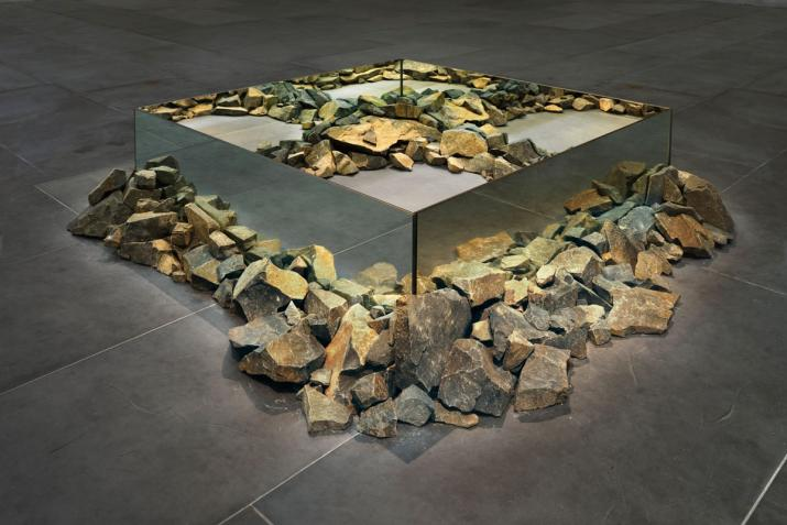 sculpture made using rocks and mirrors in a square shape