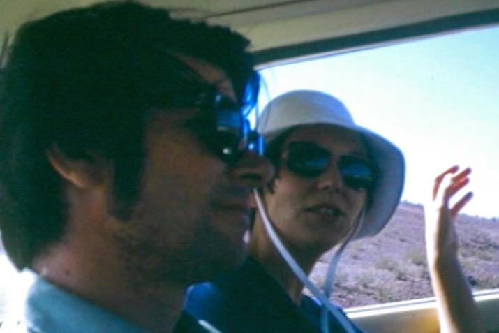profile view of two people sitting next to each other in the backseat of a car