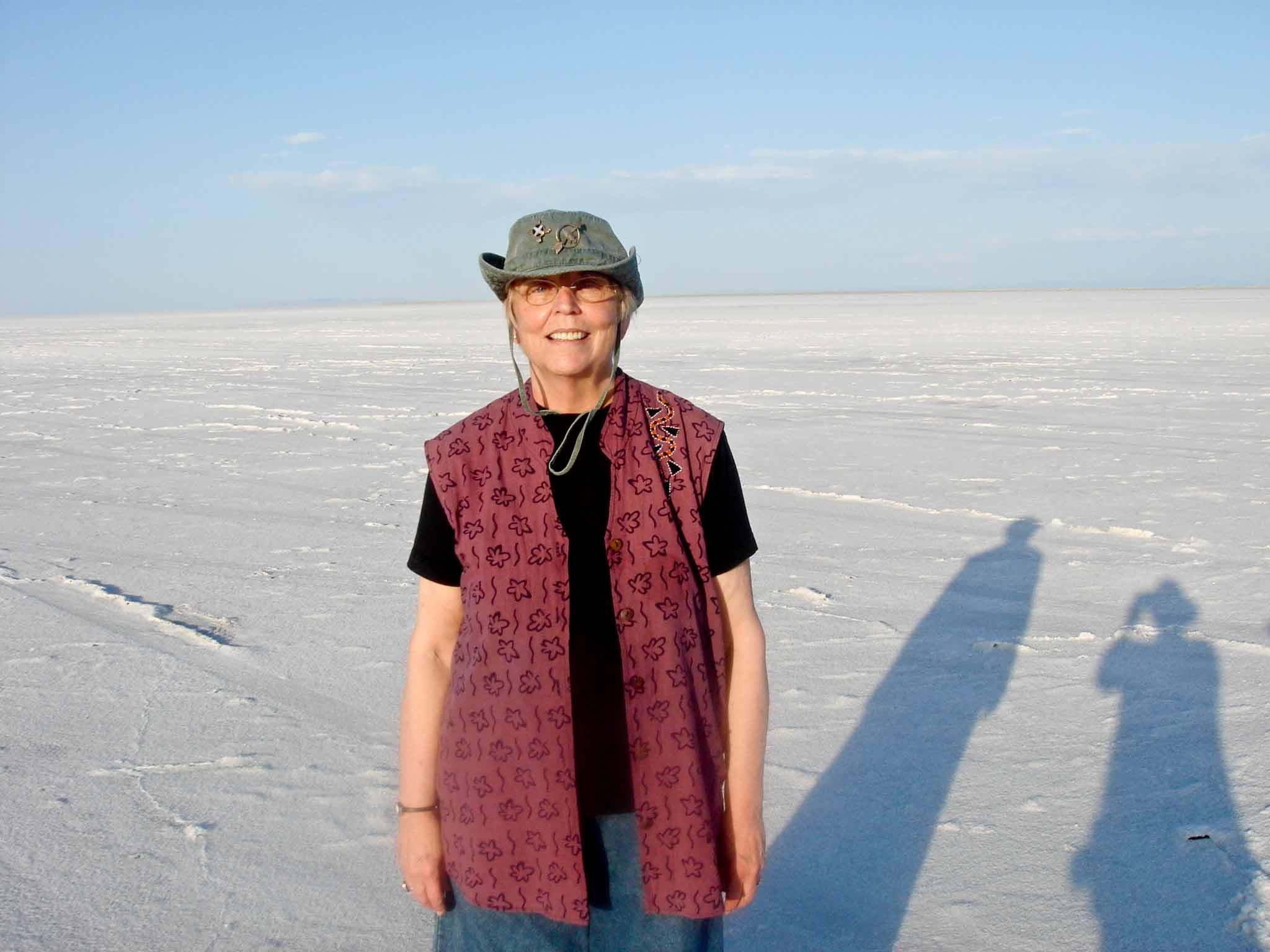 Nancy Holt stranding alone with the Salt Flats of Utah in the background.