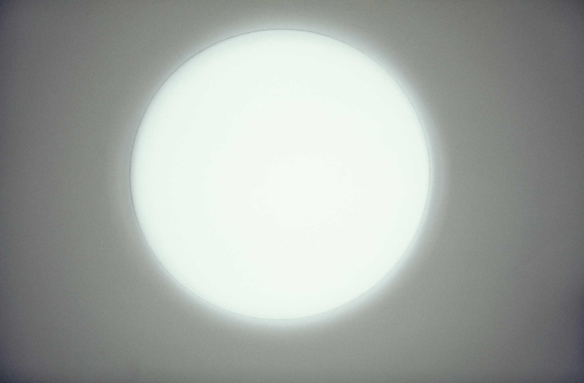 Circle of light on a white wall