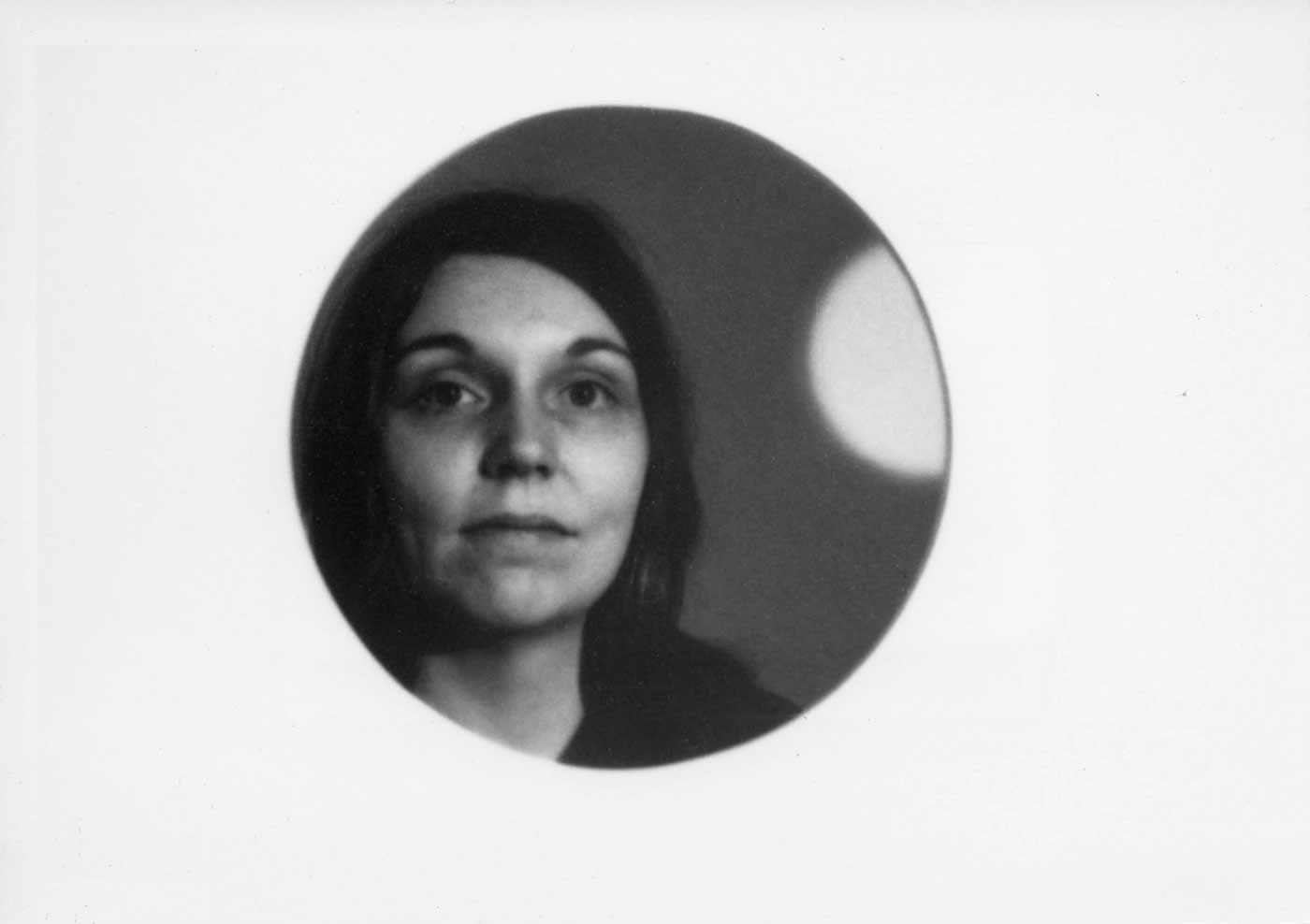 Nancy Holt framed by a circular hole in her installation Holes of Light, January 1973.