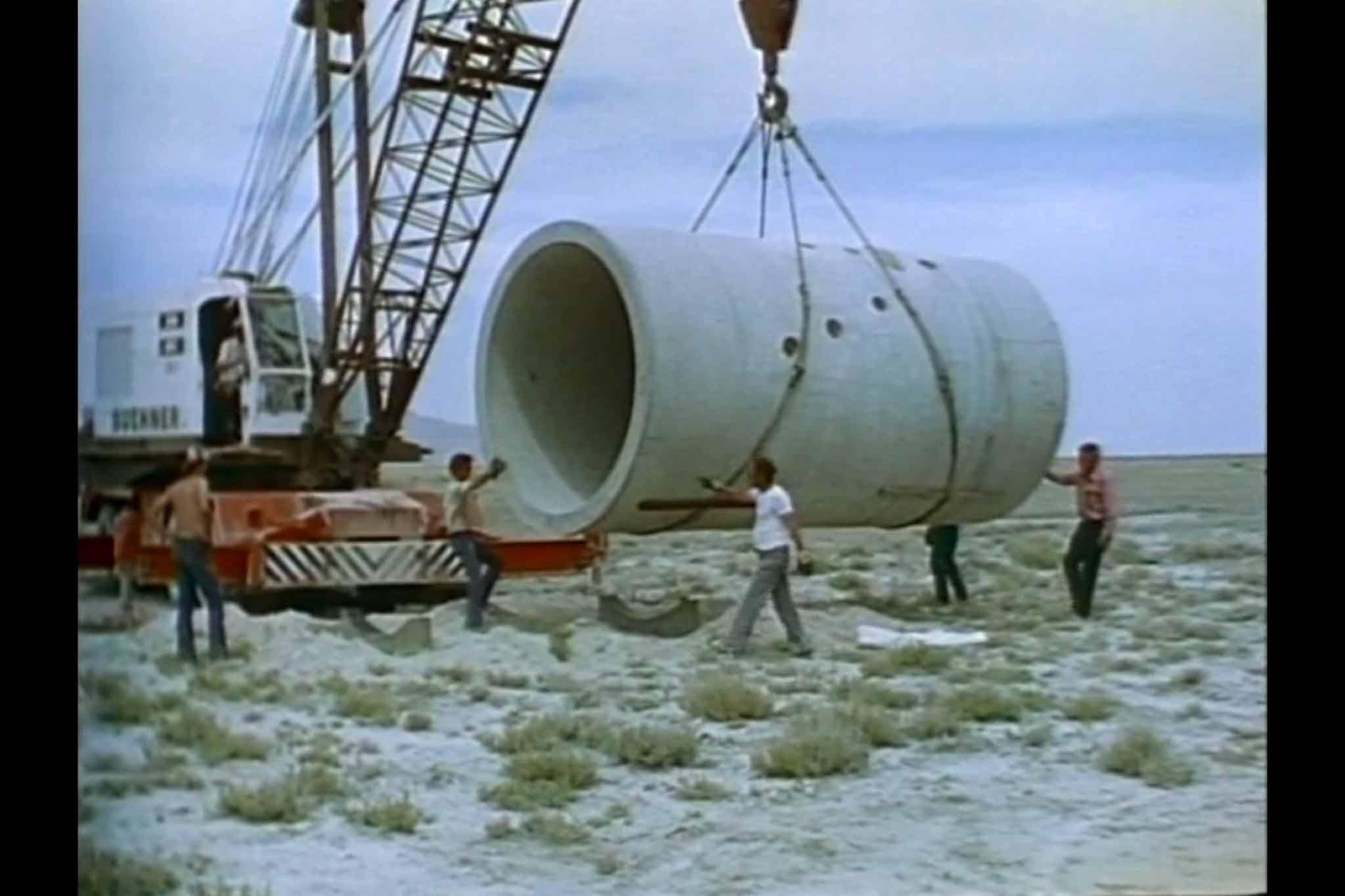 A film still from the construction of Holt's Sun Tunnels from the film, Sun Tunnels.