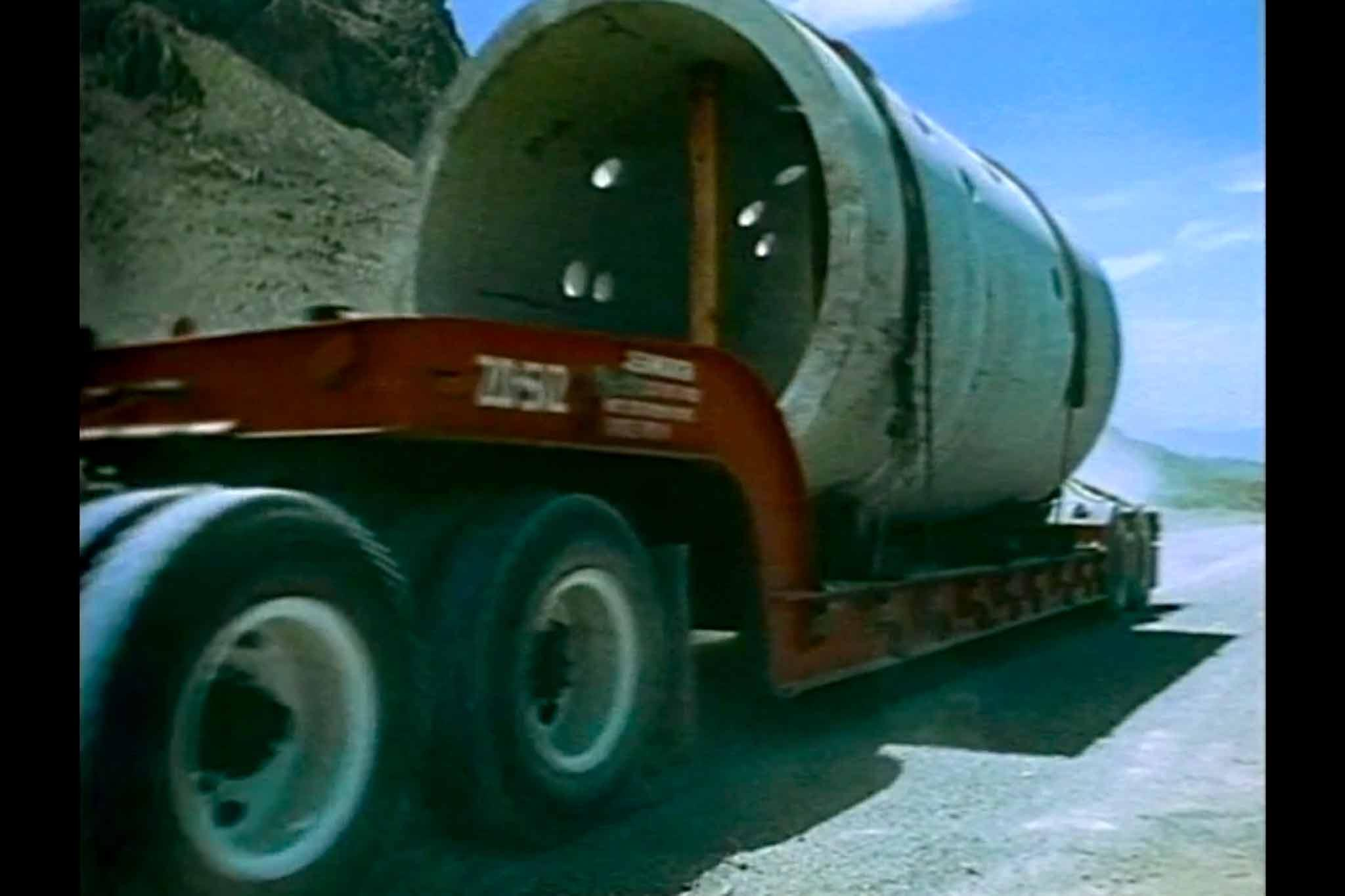 A film still of the construction of Holt's Sun Tunnels from the film, Sun Tunnels.