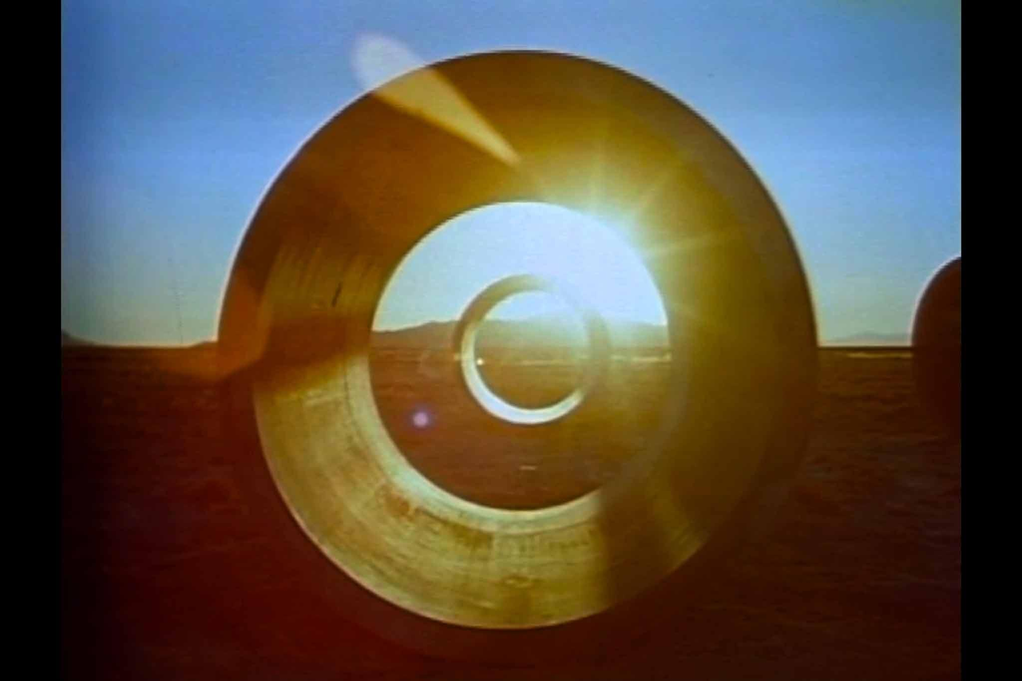 A still from the Sun Tunnels film showing sunset through one of the tunnels.