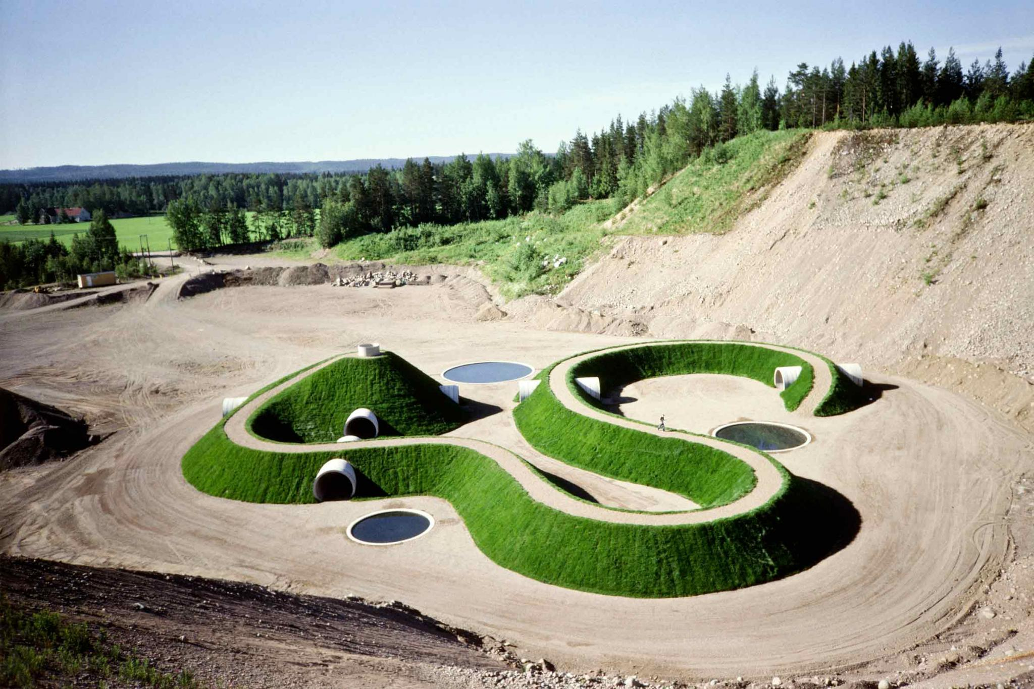 a curving mound of earth with tunnels and pathways throughout