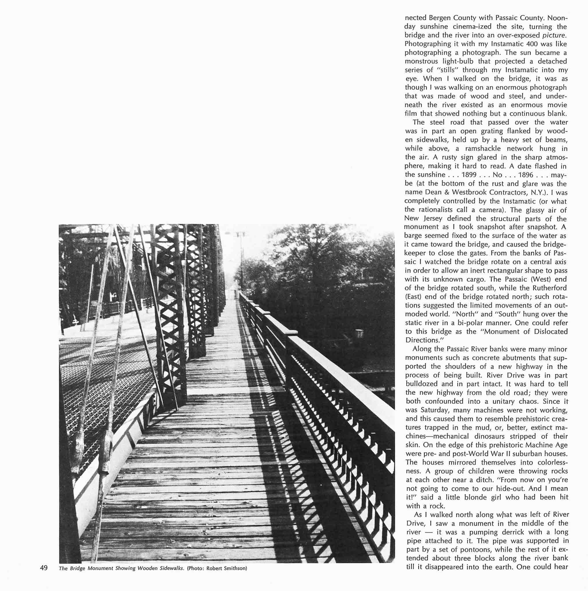 Magazine layout with one large black and white image of a walkway on a bridge on the left and a column of text on the right.