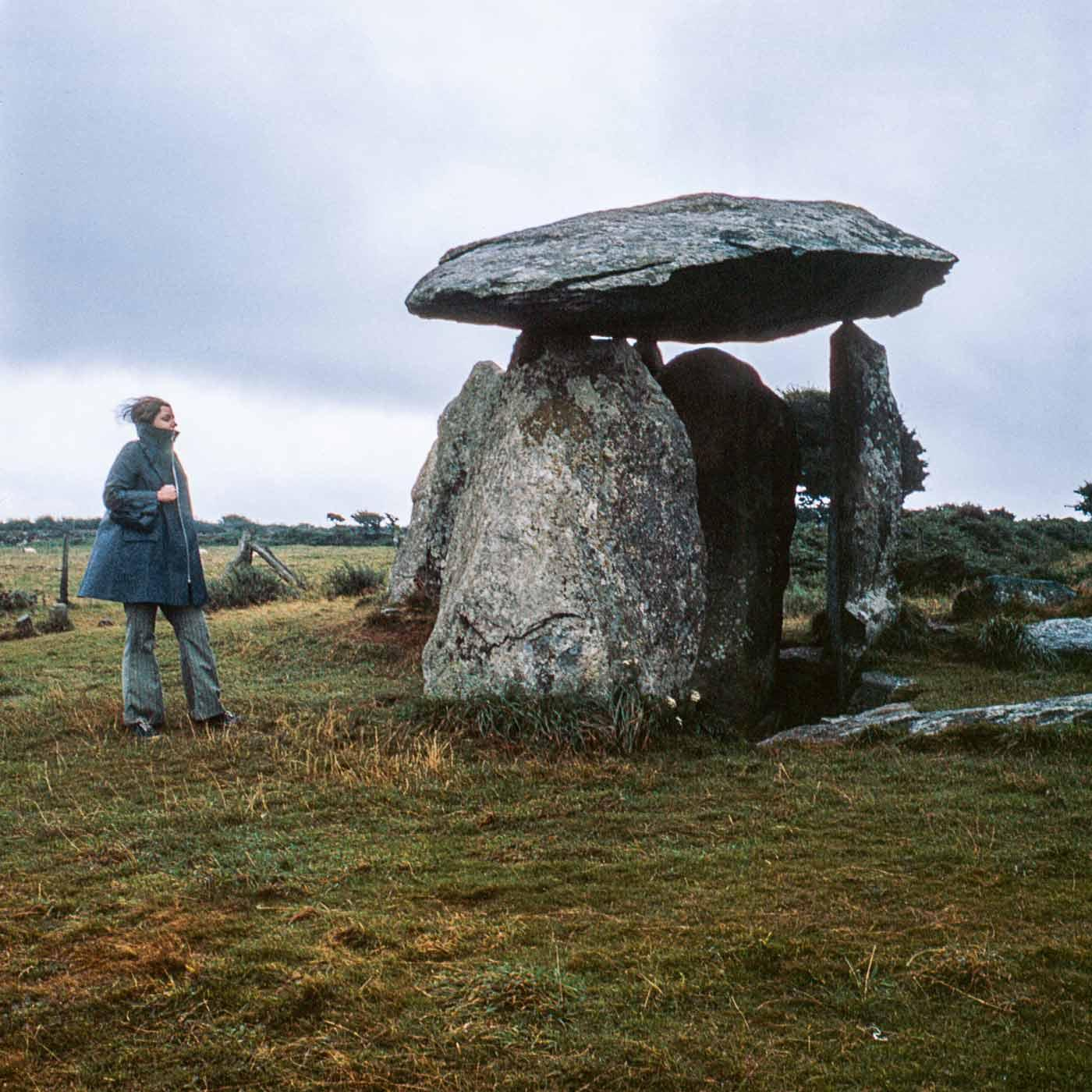 Nancy Holt standing next to an arch shaped dolmen at Pembrokeshire Coast National Park, Wales. October 1969