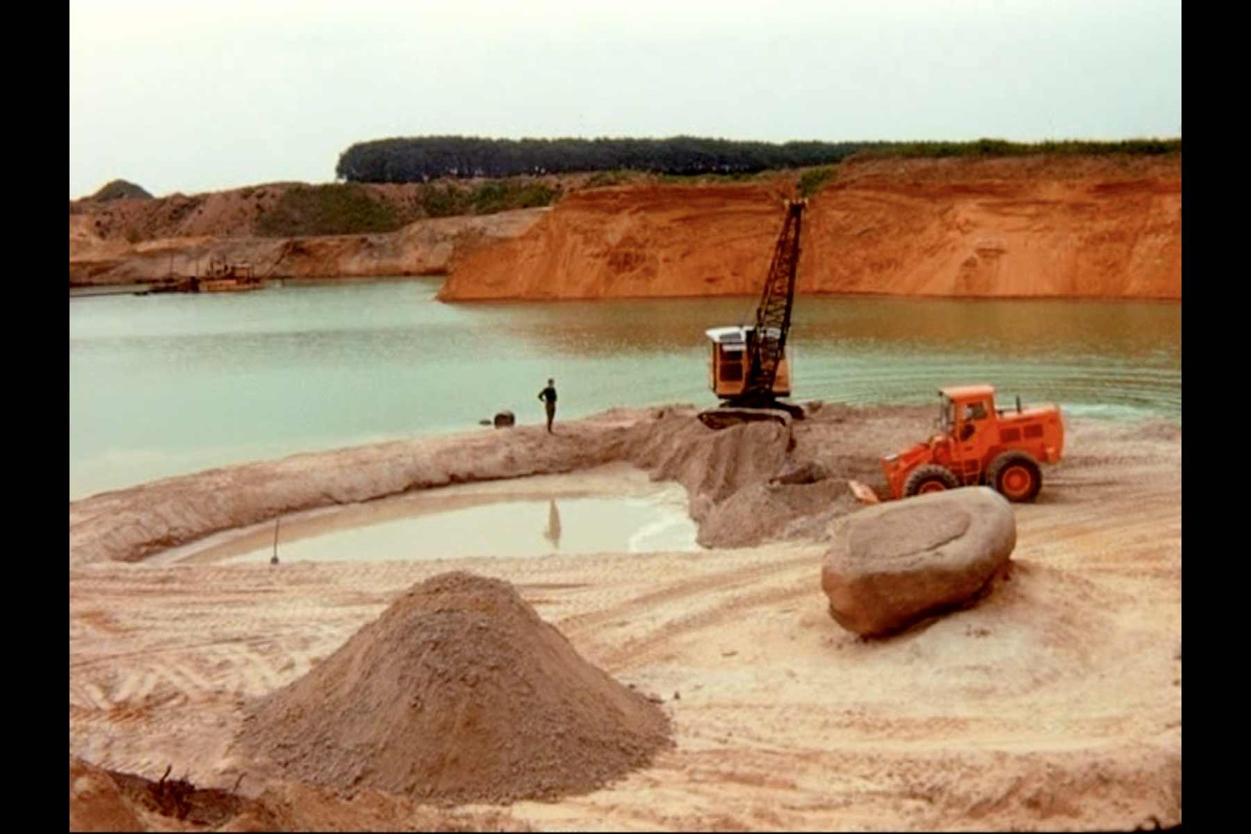 A still image from the film Breaking Ground: Broken Circle/Spiral Hill. Broken Circle during construction, 1971. Film footage by Nancy Holt.