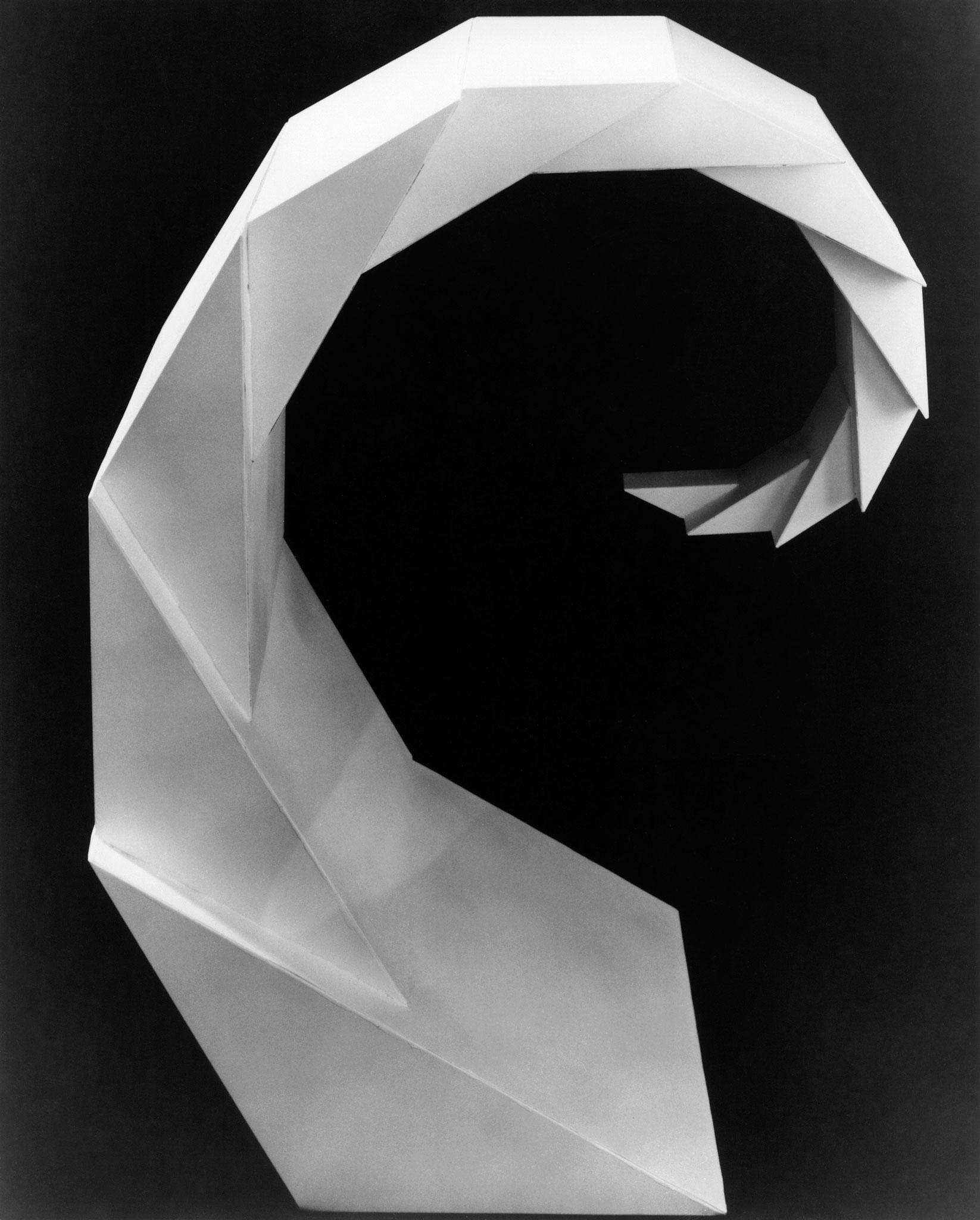 black and white image of geometric, faceted spiraling sculpture