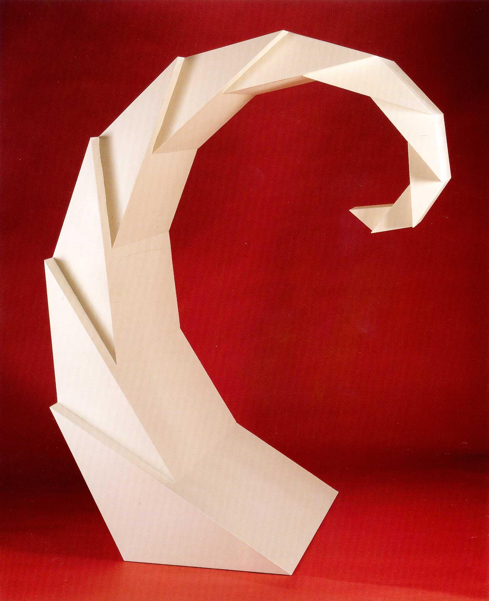 white geometric, faceted spiraling sculpture with a red background