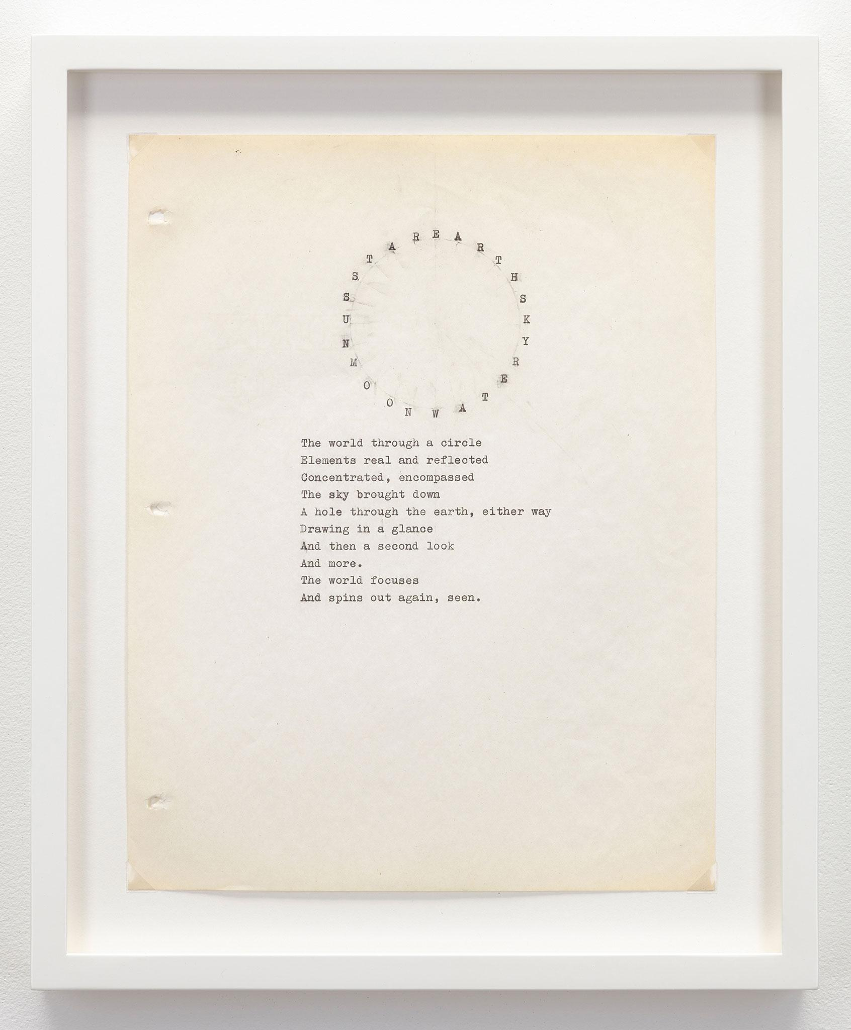 framed typewritten paper with words in a circle shape above a paragraph poem