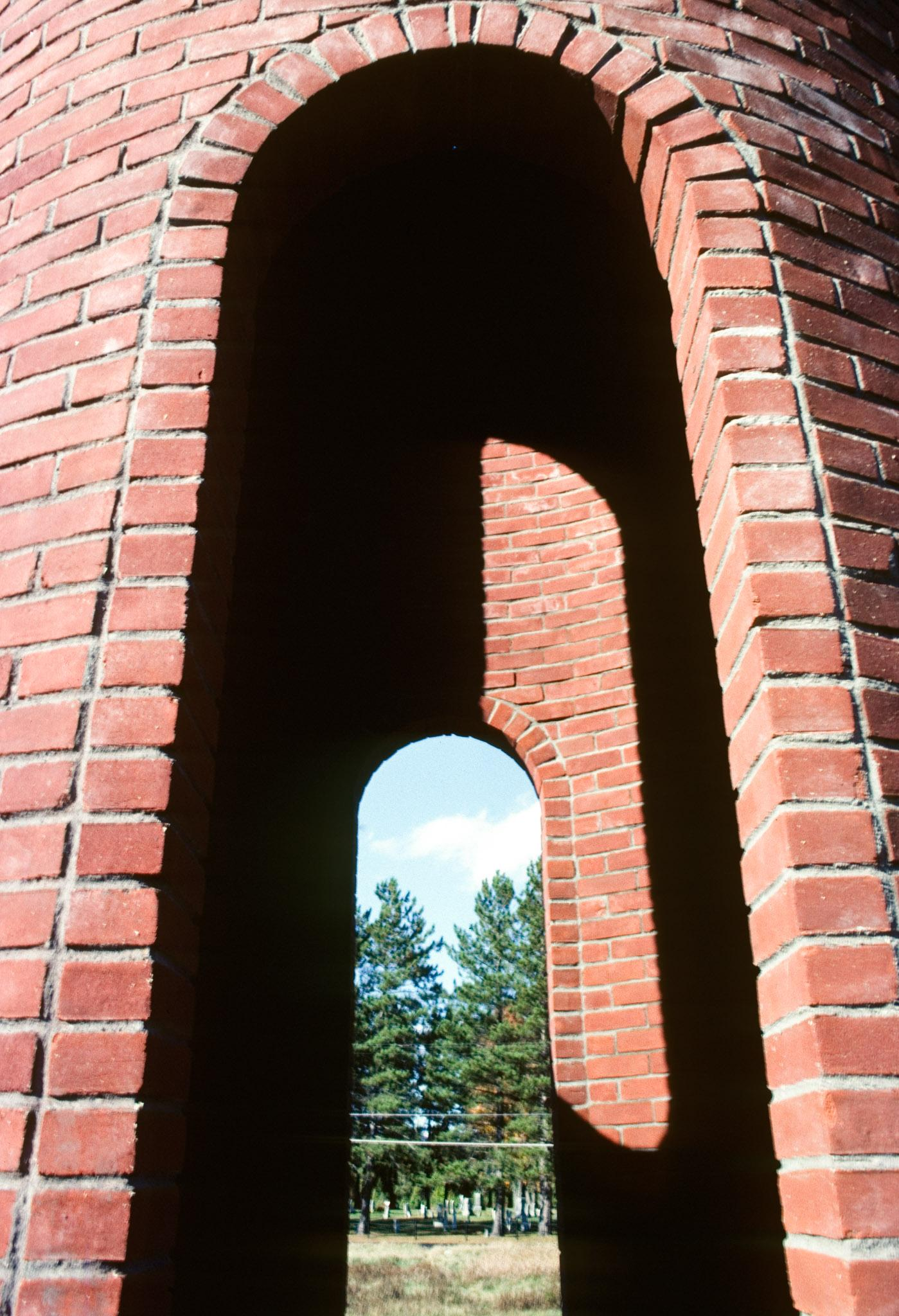 looking through two oval shaped windows in a brick structure