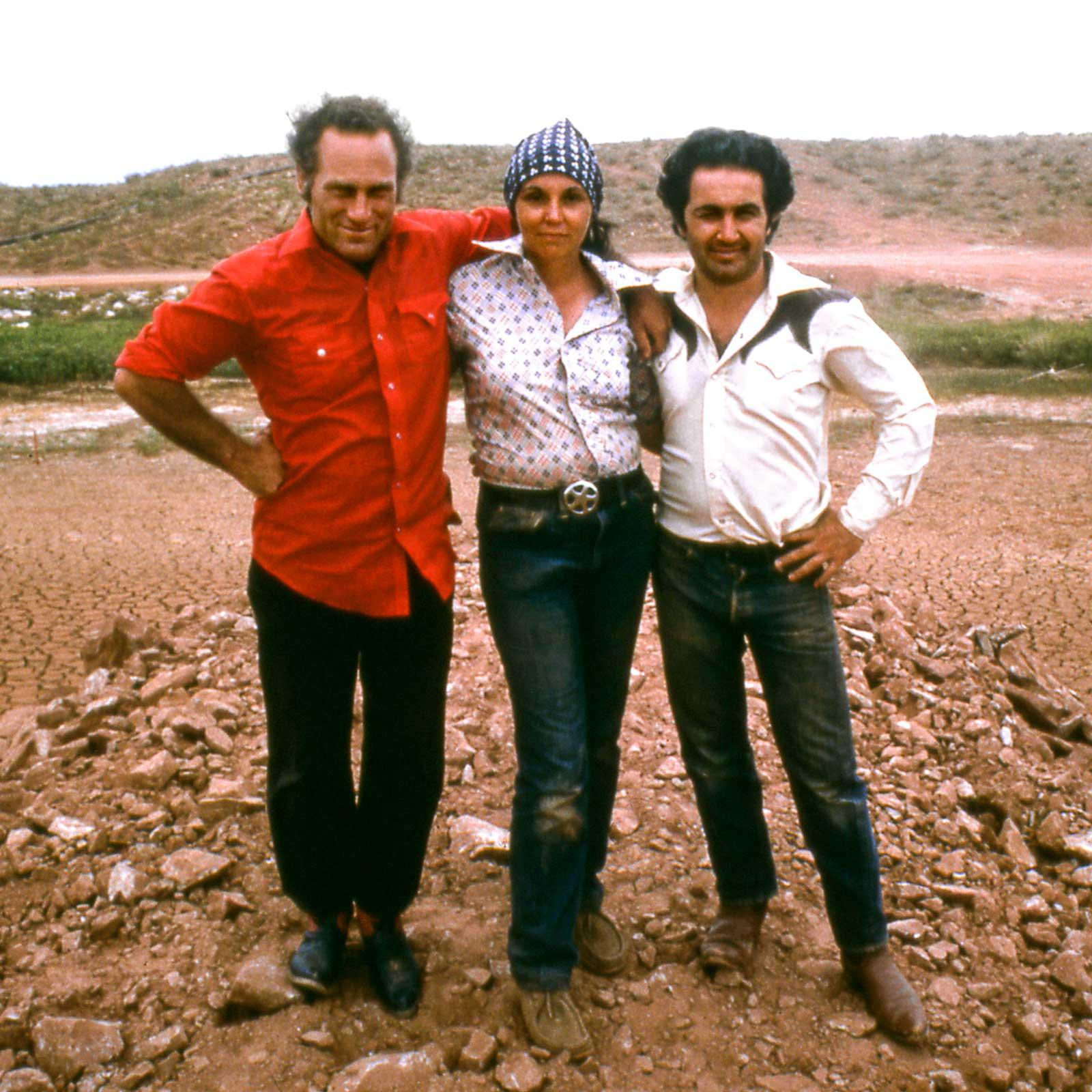 Three figures standing at the site of Amarillo Ramp in Texas